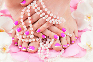 Pink manicure and pedicure.